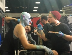 """Winner of the SyFy show """"Face Off"""" doing some makeup on the spot."""